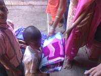 orphanage receiving the donated blanket
